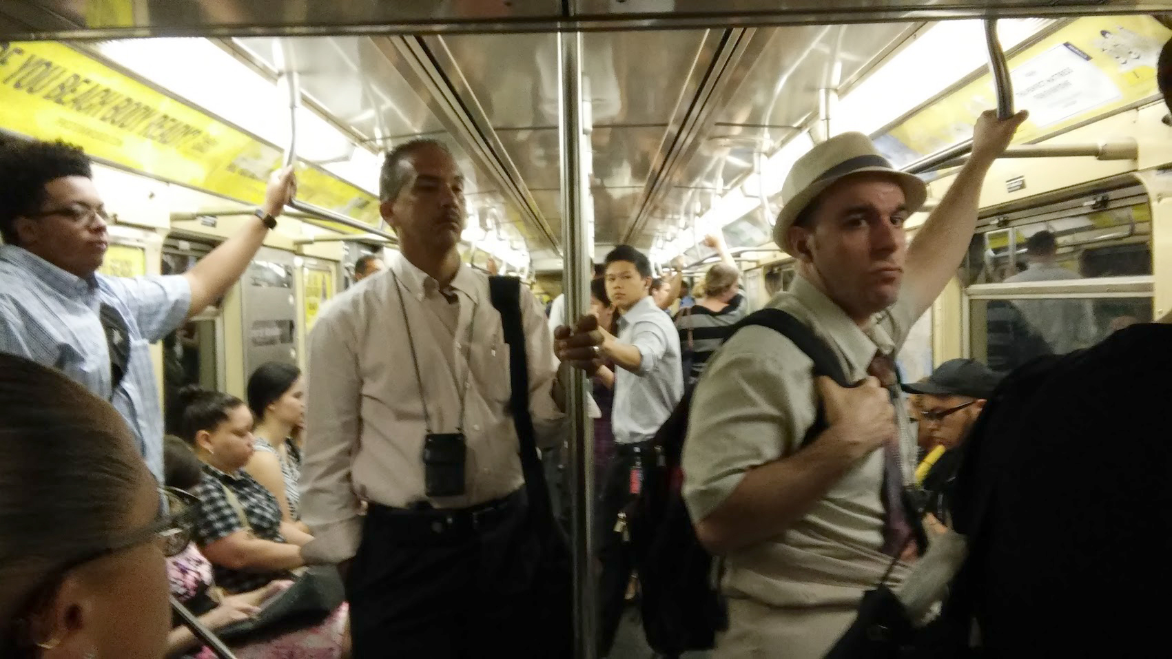 Straphangers ride the rails during the often crowded subway commute.