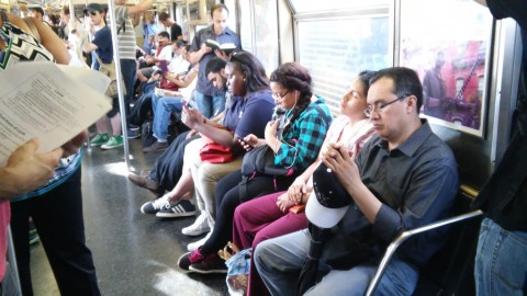 Cramming in on the J train.